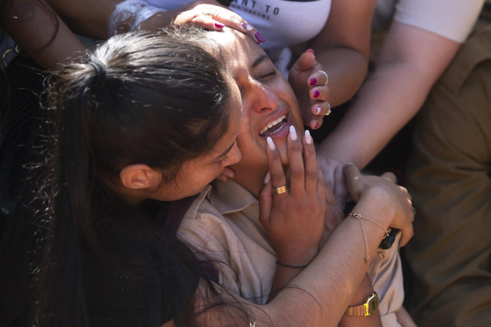 Friends and relatives of Israeli soldier Omer Tabib, 21, mourn during his funeral at the cemetery in the northern Israeli town of Elyakim, Thursday, May 13, 2021. The Israeli army confirmed that Tabib was killed in an anti-tank missile attack near the Gaza Strip, the first Israeli military death in the current fighting between Israelis and Palestinians. (AP Photo/Sebastian Scheiner)