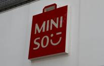 FILE PHOTO: The logo of Chinese low-cost lifestyle and consumer products retailer Miniso is pictured in Tokyo