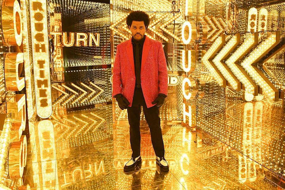 <p>For this year's Super Bowl halftime show, The Weeknd wore a black and red glittering ensemble by Givenchy. </p>
