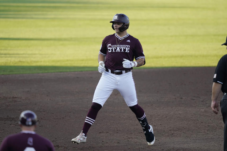 Mississippi State's Logan Tanner (19) skips as he rounds third base after hitting a second-inning three-run home run against Notre Dame during an NCAA college baseball super regional game, Monday, June 14, 2021, in Starkville, Miss. (AP Photo/Rogelio V. Solis)