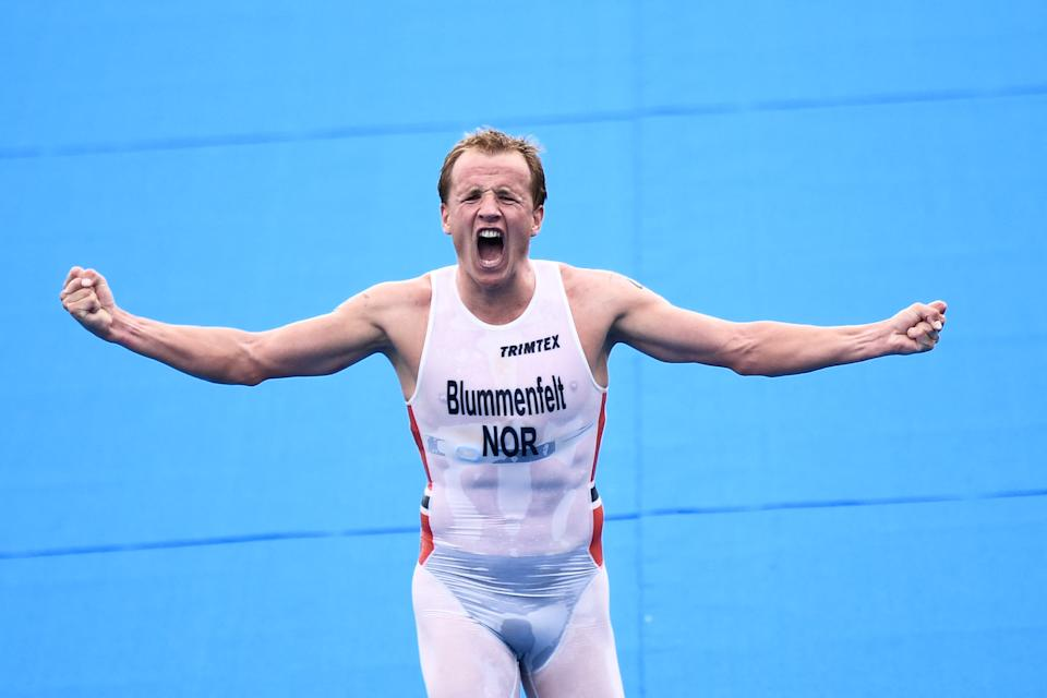 <p>Norway's Kristian Blummenfelt celebrates finishing first in the men's individual triathlon competition during the Tokyo 2020 Olympic Games at the Odaiba Marine Park in Tokyo on July 26, 2021. (Photo by Loic VENANCE / AFP)</p>