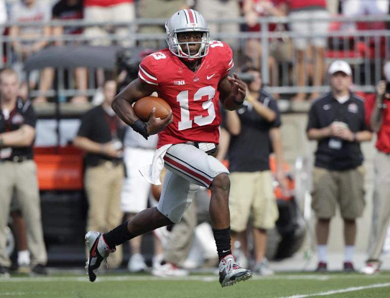 Ohio State quarterback Kenny Guiton breaks away for a touchdown run against San Diego State during the second quarter of an NCAA college football game Saturday, Sept. 7, 2013, in Columbus, Ohio. (AP Photo/Jay LaPrete)