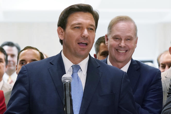 FILE - In this April 30, 2021, file photo surrounded by lawmakers, Florida Gov.Ron DeSantis speaks at the end of a legislative session at the Capitol in Tallahassee, Fla. Now that the pandemic appears to be waning and DeSantis is heading into his reelection campaign next year, he has emerged from the political uncertainty as one of the most prominent Republican governors and an early White House front-runner in 2024 among Donald Trump's acolytes, if the former president doesn't run again. (AP Photo/Wilfredo Lee, File)