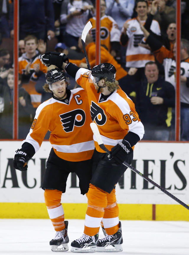 Philadelphia Flyers' Claude Giroux (28) and Jakub Voracek (93), of the Czech Republic, celebrate after Giroux's goal during the third period of an NHL hockey game against the Toronto Maple Leafs, Friday, March 28, 2014, in Philadelphia. Philadelphia won 4-2. (AP Photo/Matt Slocum)