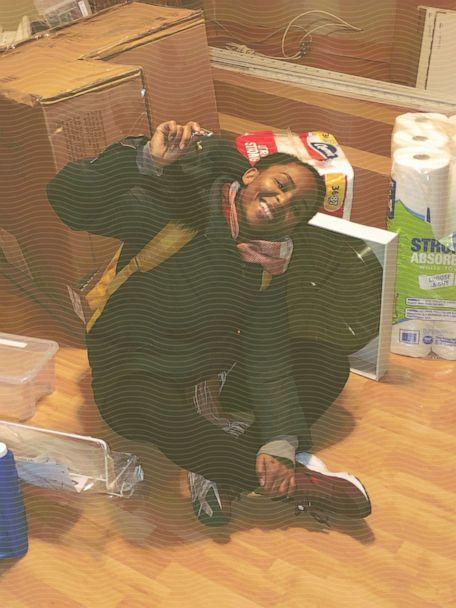 PHOTO: Melissa Jean-Baptiste sits on the floor of her new home with keys in hand the same day she closed on her house in January 2019. (Courtesy Melissa Jean-Baptiste )