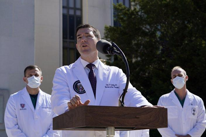 Dr. Sean Conley, physician to President Donald Trump, briefs reporters at Walter Reed National Military Medical Center in Bethesda, Md., Saturday, Oct. 3, 2020. (AP Photo/Susan Walsh)