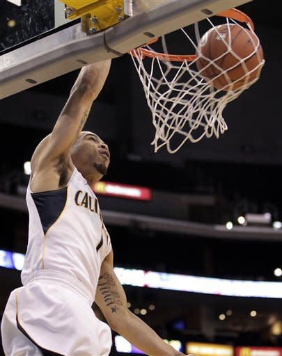 California's Justin Cobbs dunks during the first half of an NCAA college basketball game against Stanford at the Pac-12 conference championship in Los Angeles, Thursday, March 8, 2012. (AP Photo/Jae C. Hong)