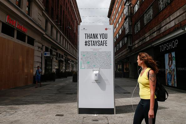 A City of Westminster hand sanitiser station on Oxford Street in London, England.