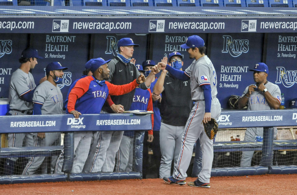 Texas Rangers greet starting pitcher Kohei Arihara at the dugout after he was pulled during the sixth inning against the Tampa Bay Rays in a baseball game Wednesday, April 14, 2021, in St. Petersburg, Fla. (AP Photo/Steve Nesius)