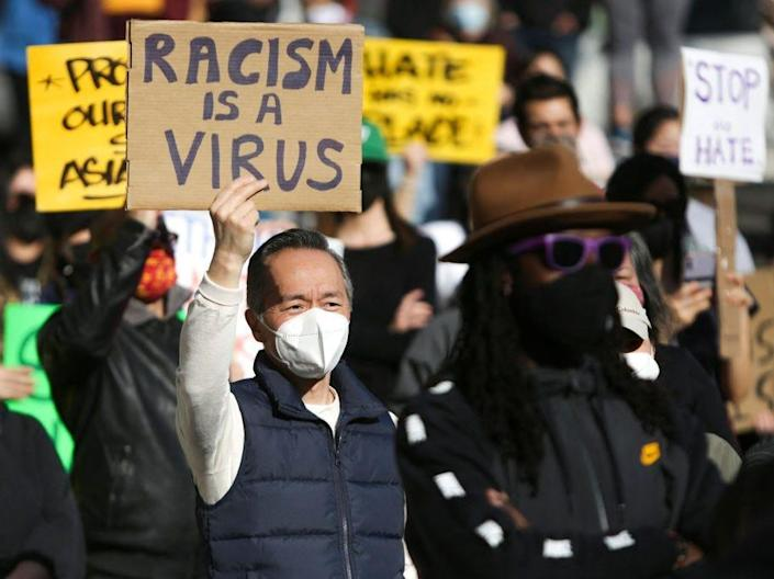 Racism is a virus AAPI stop the hate protest