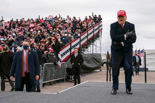 PHOTO: President Donald Trump takes the stage for a rally at Oakland County International Airport, Nov. 1, 2020, in Waterford Township, Mich. (Evan Vucci/AP)
