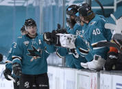 San Jose Sharks center Patrick Marleau (12) is congratulated by teammates after scoring a goal against the Anaheim Ducks during the second period of an NHL hockey game Tuesday, April 6, 2021, in San Jose, Calif. (AP Photo/Tony Avelar)