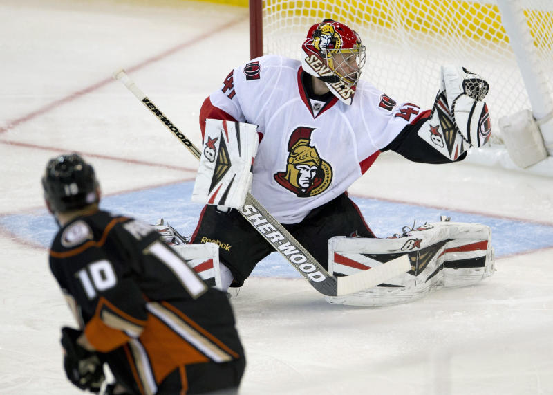 Ottawa Senators goalie Craig Anderson makes a save on a shot from Anaheim Ducks right wing Corey Perry during the first period of an NHL hockey game, Friday Oct. 25, 2013 in Ottawa, Ontario. (AP Photo/The Canadian Press, Adrian Wyld)