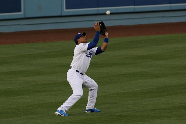 LOS ANGELES, CA - JUNE 16: Bobby Abreu #23 of the Los Angeles Dodgers catches a fly ball against the Chicago White Sox for the third out in the second inning at Dodger Stadium on June 16, 2012 in Los Angeles, California. (Photo by Jeff Golden/Getty Images)