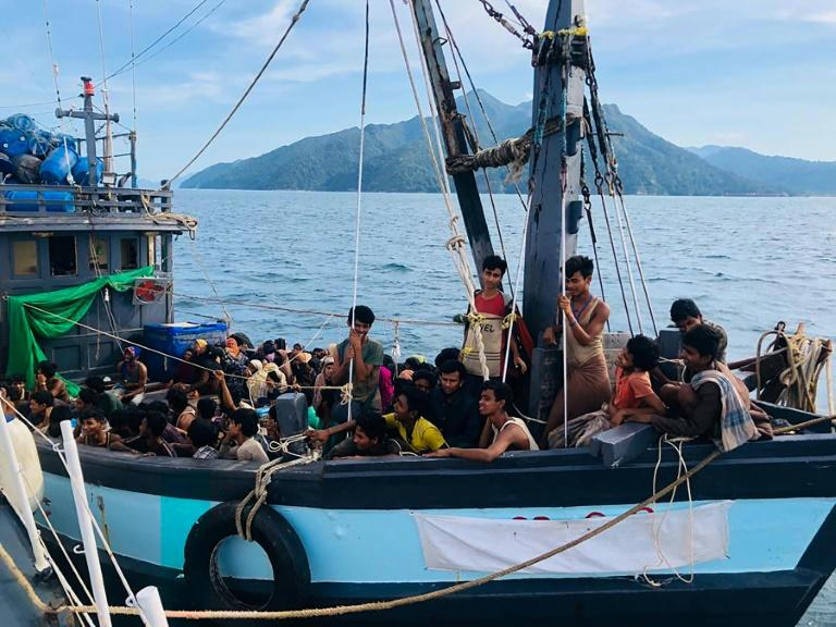 Malaysian authorities have arrested two people suspected of being human traffickers in connection with the arrival of this boat crammed with Rohingya migrants in Langkawi on April 5