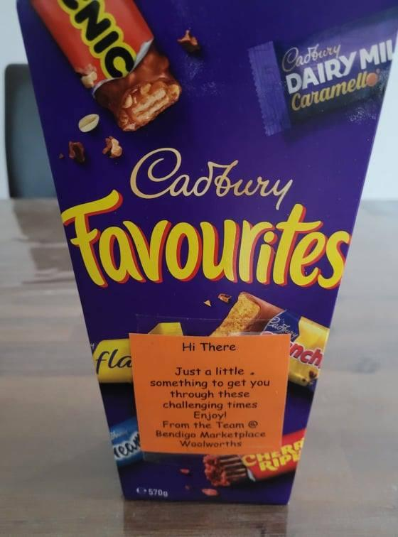 A photo of Cadbury chocolate Favourites and a note given to Woolworths customer.