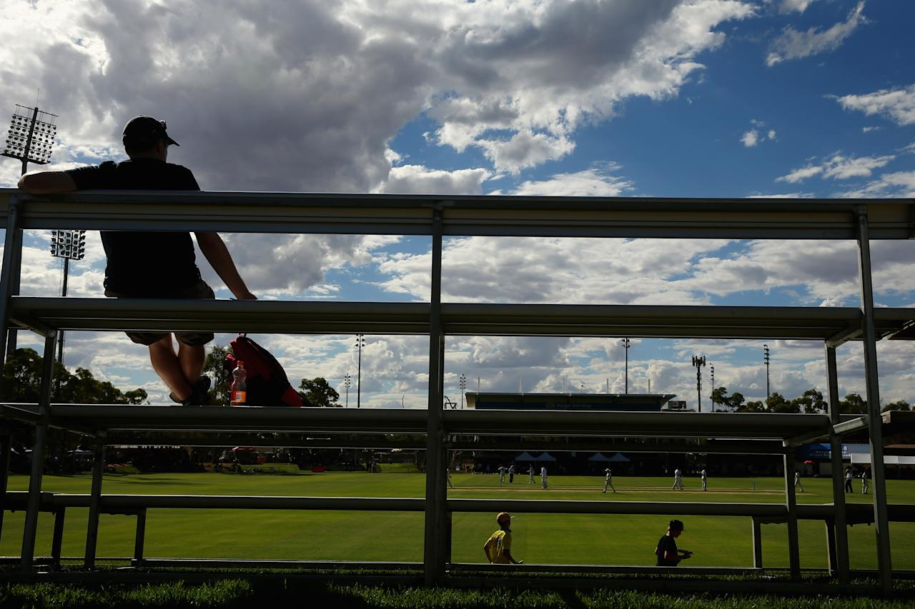 ALICE SPRINGS, AUSTRALIA - NOVEMBER 29:  A general view is seen as a spectator watches on during day one of the tour match between the Chairman's XI and England at Traeger Park on November 29, 2013 in Alice Springs, Australia.  (Photo by Mark Kolbe/Getty Images)
