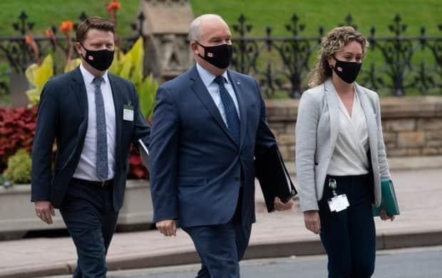 Conservative Leader Erin O'Toole walks with his chief of staff Tausha Michaud, right, and campaign manager Fred DeLorey, left, in Ottawa. DeLorey said Friday the party must pivot to appeal to disaffected voters.