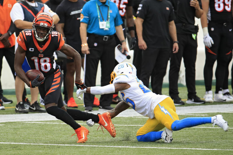 CINCINNATI, OHIO - SEPTEMBER 13: Wide receiver A.J. Green #18 of the Cincinnati Bengals rushes past cornerback Casey Hayward #26 of the Los Angeles Chargers during the second half at Paul Brown Stadium on September 13, 2020 in Cincinnati, Ohio. (Photo by Andy Lyons/Getty Images)