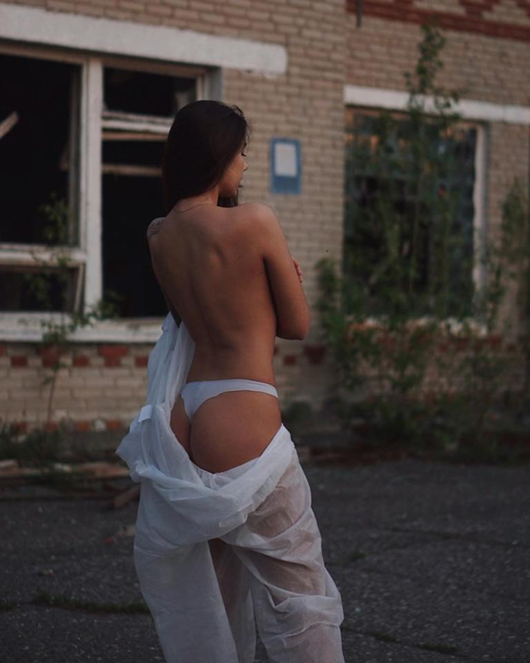 """A Chernobyl <a href=""""https://www.instagram.com/p/BynsGXno3kt/"""">tourist</a> goes topless at the Pripyat, Ukraine site of the disaster in June 2019."""