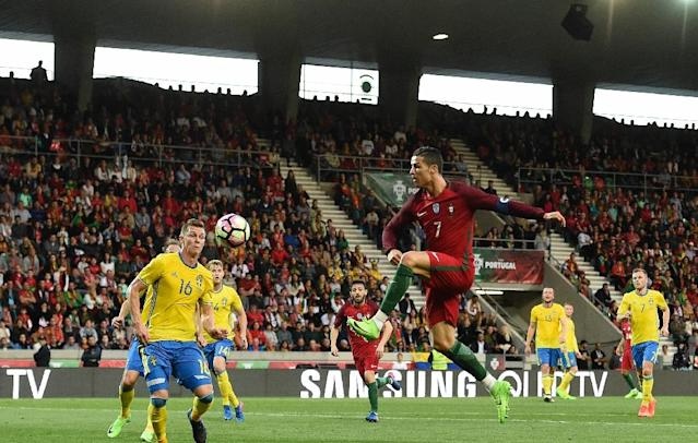 Portugal's forward Cristiano Ronaldo goes for the ball during the friendly football match Portugal vs Sweden at the Estadio dos Barreiros in Funchal on March 28, 2017 (AFP Photo/FRANCISCO LEONG)