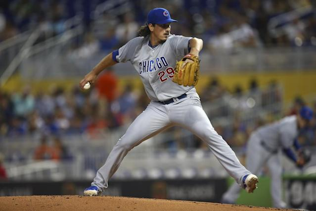 Chicago Cubs starter Jeff Samardzija pitches to the Miami Marlins during the first inning of a baseball game in Miami, Tuesday, June 17, 2014. (AP Photo/J Pat Carter)