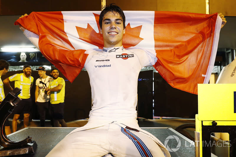 "Lance Stroll, Williams FW40, celebrates third place by displaying a Canadian flag in the pit lane<span class=""copyright"">Glenn Dunbar / LAT Images</span>"