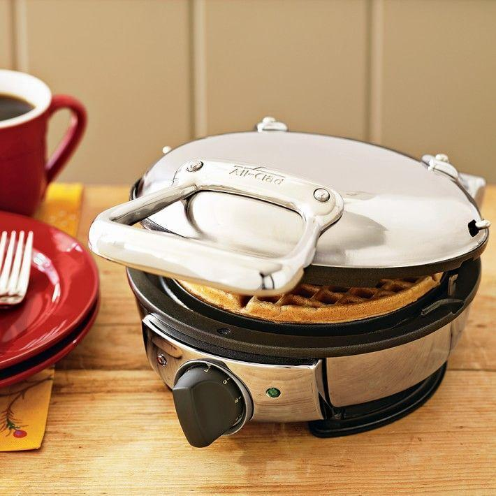 "<p><strong>All-Clad</strong></p><p>williams-sonoma.com</p><p><strong>$129.95</strong></p><p><a href=""https://go.redirectingat.com?id=74968X1596630&url=https%3A%2F%2Fwww.williams-sonoma.com%2Fproducts%2Fall-clad-classic-round-waffle-maker&sref=https%3A%2F%2Fwww.delish.com%2Fkitchen-tools%2Fg4445%2Fbest-waffle-iron%2F"" rel=""nofollow noopener"" target=""_blank"" data-ylk=""slk:BUY NOW"" class=""link rapid-noclick-resp"">BUY NOW</a></p><p>If you fall into the round waffle maker camp, this is one of the best ones appliances you can buy. It's a compact package but packs a big punch, producing <a href=""http://www.delish.com/food-news/a32098095/waffle-house-waffle-mix/"" rel=""nofollow noopener"" target=""_blank"" data-ylk=""slk:crispy waffles"" class=""link rapid-noclick-resp"">crispy waffles</a> with fluffy insides at a modest price point. Customers love it for its durable design and seven different temperature settings.</p>"