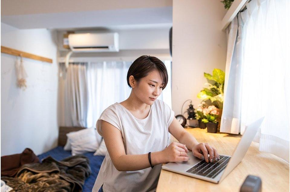 Young woman working at home in the morning - stock photo