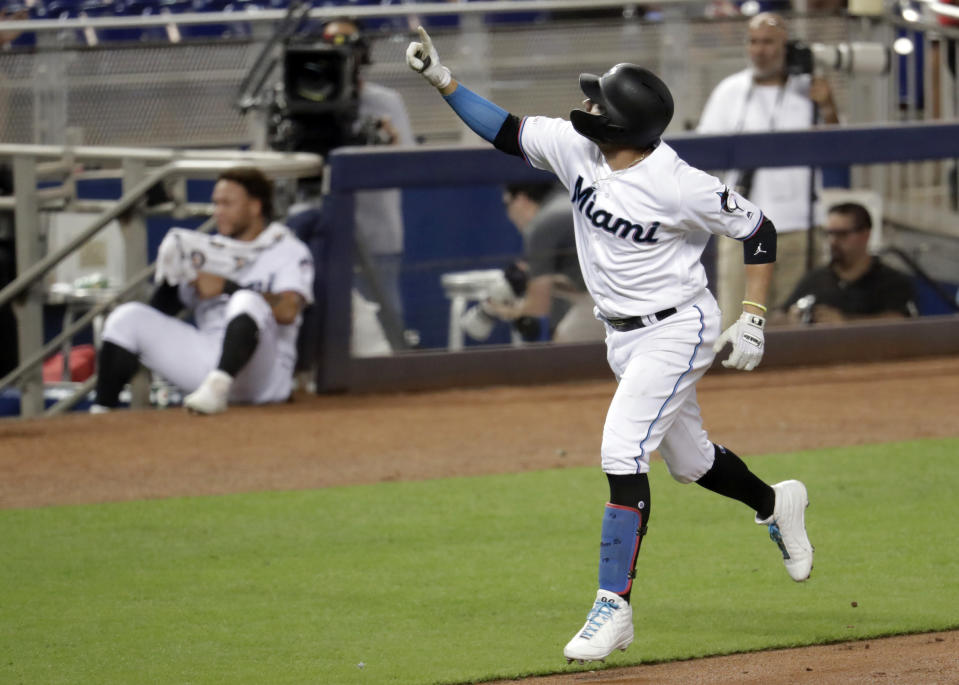 Miami Marlins' Miguel Rojas reacts after hitting a solo home run during the second inning of a baseball game against the Arizona Diamondbacks, Monday, July 29, 2019, in Miami. (AP Photo/Lynne Sladky)