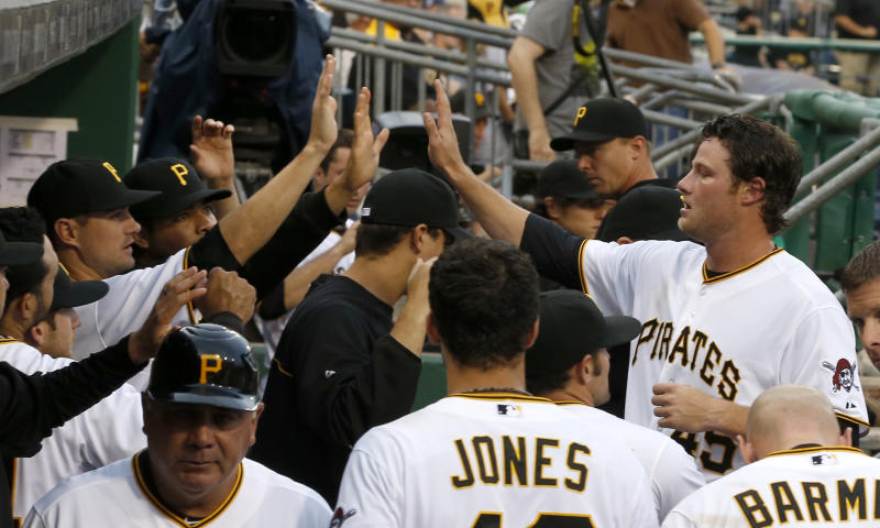 Pittsburgh Pirates starting pitcher Gerrit Cole, right, is greeted in the dugout by teammates after the second inning of the baseball game against the San Francisco Giants on Tuesday, June 11, 2013, in Pittsburgh. Cole got a single in his first major league at bat with the bases loaded and drove in two runs. (AP Photo/Keith Srakocic)