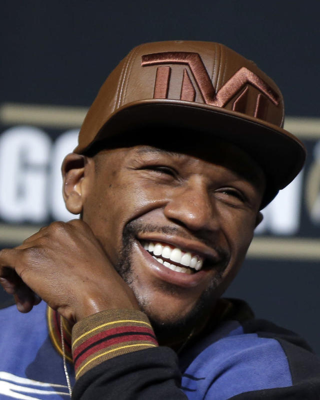 Boxer Floyd Mayweather Jr. laughs during a news conference Wednesday, April 30, 2014, in Las Vegas. Mayweather will face Marcos Maidana in a welterweight title fight on Saturday, May 3. (AP Photo/Isaac Brekken)