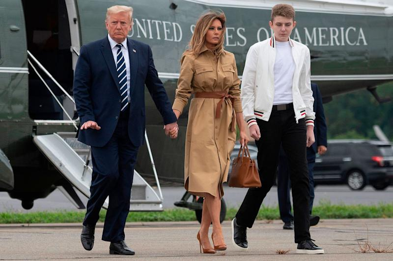 Melania Trump pushes her husband's hand away