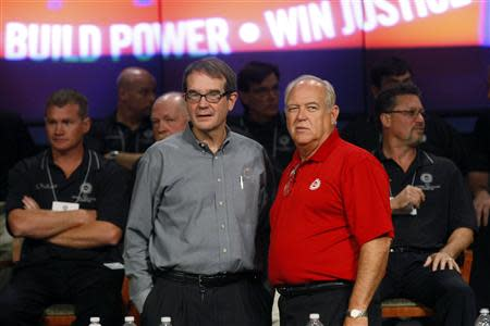 United Auto Workers (UAW) President Bob King (2nd L) and Secretary-Treasurer Dennis Williams (2nd R) talk with each other before announcing a tentative labor agreement with General Motors in Warren, Michigan September 20, 2011. REUTERS/Rebecca Cook