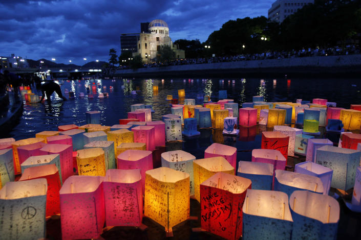 Paper lanterns float along the Motoyasu River in front of the illuminated Atomic Bomb Dome near Hiroshima Peace Memorial Park in Hiroshima, western Japan, Saturday, Aug. 6, 2011. The Japanese city of Hiroshima on Saturday marked the 66th anniversary of the bombing, as the nation fights a different kind of disaster from atomic technology - a nuclear plant in a meltdown crisis after being hit by a tsunami. (AP Photo/Koji Sasahara)