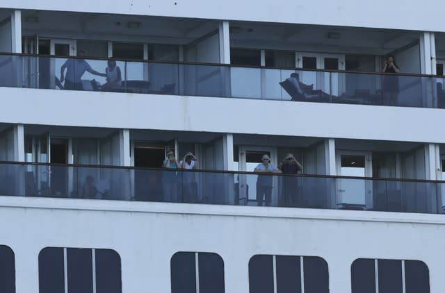 Passengers look out from the Zaandam cruise ship (Arnulfo Franco/AP Images)