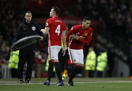 Manchester United's Chris Smalling comes on as a substitute to replace Phil Jones