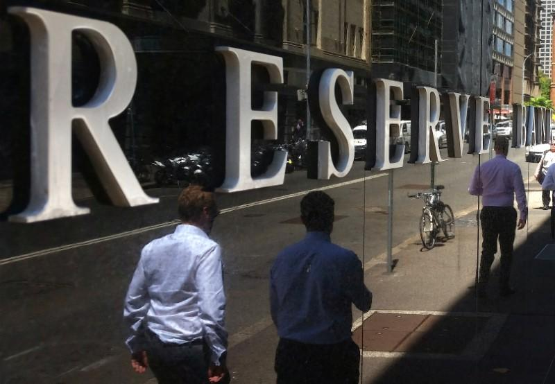 Australia central bank buys $2.9 billion of bonds in first round of unlimited QE