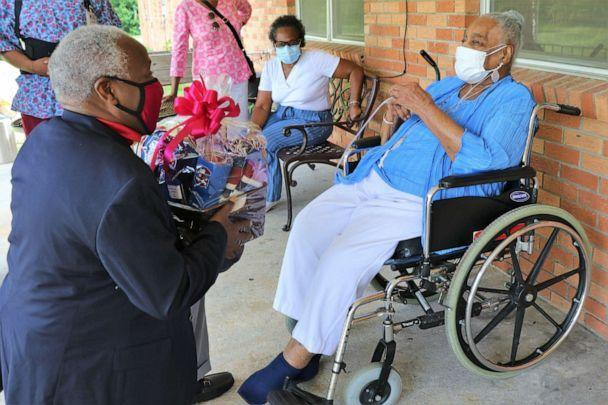 PHOTO: Catherine Miller celebrated her birthday on June 8 having survived a bout with COVID-19 last year. Miller, an alumna, was presented with South Carolina State University merchandise by James E. Clark, president of the university. (South Carolina State University)