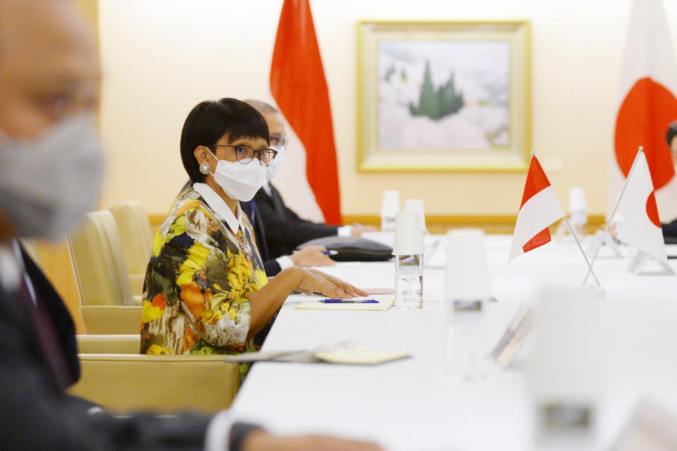 Indonesia's Foreign Minister Retno Marsudi speaks with Japan's Foreign Minister Toshimitsu Motegi, not seen, during the Japan Indonesia Foreign Ministers meeting in Tokyo on Monday, March 29, 2021. Indonesian Foreign Minister Retno Marsudi and Defense Minister Prabowo Subianto are in Japan from March 28-30, 2021.(David Mareuil/Pool Photo via AP)
