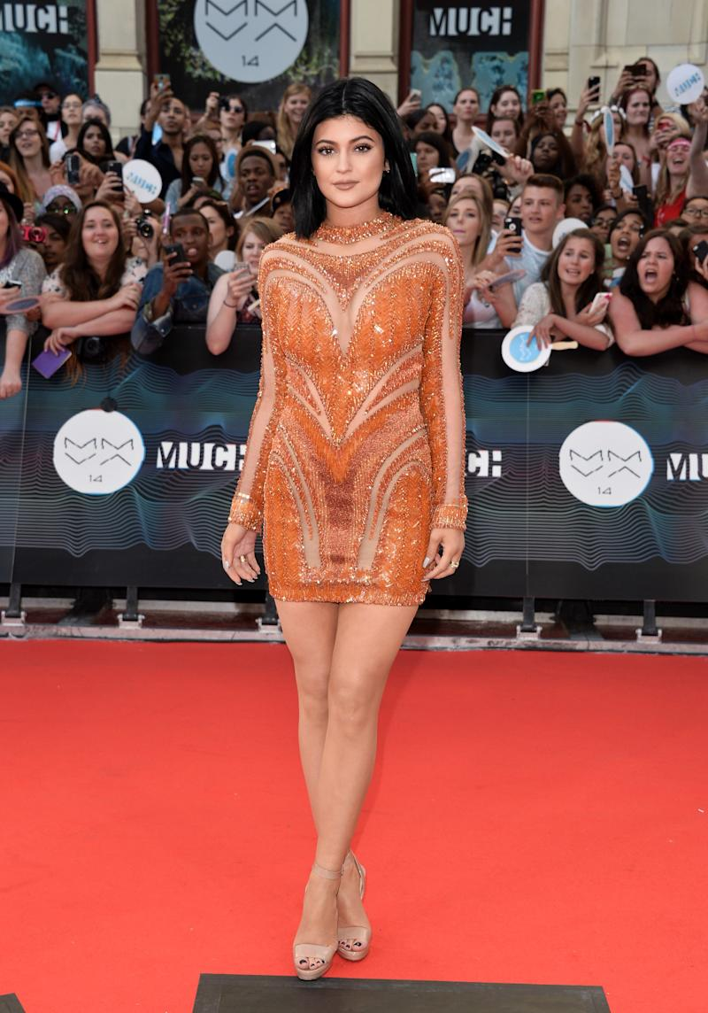 Jenner opted for an orange Nicolas Jebran minidress, contrasting with her sister's Fausto Puglisi, at the MuchMusic Video Awards in Toronto, Canada, June 2014.