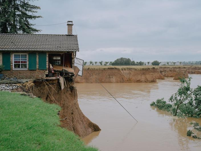 """A house damaged by floods in Erfstadt Blessem, Germany, July 16, 2021.<span class=""""copyright"""">DOCKS Collective</span>"""