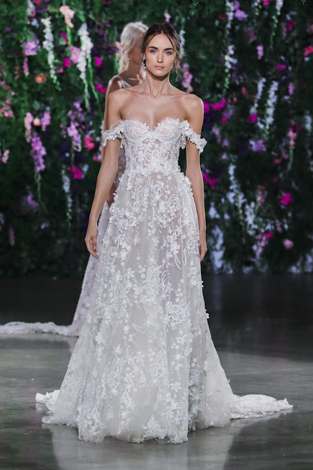 <p>Off the shoulder with all of the floral appliqué you could wish for. This is a serious princess moment.</p>