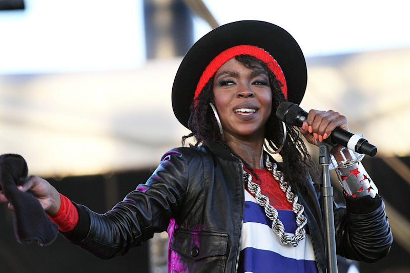 "FILE - This April 15, 2011 file photo shows singer Lauryn Hill performing during the 12th Coachella Valley Music and Arts Festival in Indio, Calif. Hill says she has signed with Sony to pay her overdue taxes. Hill pleaded guilty last year to not paying federal taxes on $1.8 million earned from 2005 to 2007. The 37-year-old posted on her Tumblr late Thursday that she ""signed a new record deal, and that I did this to pay taxes."" The total Hill owes is in dispute, but it is around $1 million. Her next sentencing is May 6. (AP Photo/Spencer Weiner, file)"
