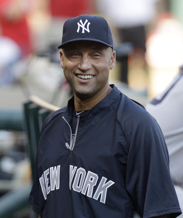 FILE - In a July 22, 2013 file photo New York Yankees shortstop Derek Jeter laughs while standing in the dugout with teammates during the baseball game against the Texas Rangers in Arlington, Texas. New York Yankees shortstop Derek Jeter has resumed on-field work Monday Jan.20, 2014, for the first time since his 2013 season was cut short. (AP Photo/LM Otero, file)