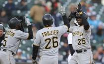 Pittsburgh Pirates' Gregory Polanco is greeted by teammates Adam Frazier (26) and Josh Harrison after they scored on Polanco's three-run home run during the 13th inning of a baseball game against the Detroit Tigers, Friday, March 30, 2018, in Detroit. (AP Photo/Carlos Osorio)
