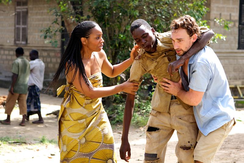 """In this Thursday, May, 17. 2012 photo released by Yellow sun ltd, unidentified actors act in a film ''Half of a yellow sun'' an adaptation of novelist Chimamanda Ngozi Adichie's book, in Calabar, Nigeria. Nigerian censors are effectively banning the film """"Half of a Yellow Sun"""" and will not even say why, the Nigerian-British producers told The Associated Press Thursday amid suspicions that censors fear it could rouse tribal rivalries. The National Film and Video Censor Board insisted it has not banned the movie but delayed its registration over """"some unresolved issues which have to be sorted out."""" The movie's Nigeria premiere was set for last Friday. Invitations had been sent out and the film was to play in every cinema in the country. On Thursday, the board told the distributors that the film had not yet passed the registration process.""""No the film hasn't been banned but we can't show it, which technically is a ban,"""" Biyi Bandele said in a telephone interview from his home in London, where the movie placed among the 10 most popular at cinemas over the Easter weekend. It stars Oscar nominee Chiwetel Ejiofor and Thandie Newton and is an adaptation of the book by prize-winning novelist Chimamanda Ngozi Adichie. (AP Photo/ Yellow Sun Ltd)"""