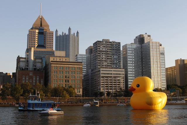 A 40-foot-high (12-metre-high) and 30-foot-wide (nine-metre-wide) inflatable rubber duck, created by Dutch artist Florentijn Hofman, is towed up the Allegheny River in Pittsburgh, Pennsylvania September 27, 2013. The event marks the North American debut of Hofman's Rubber Duck Project, which has taken place in other cities in Asia, Europe, Australia and South America. REUTERS/Jason Cohn (UNITED STATES - Tags: SOCIETY TPX IMAGES OF THE DAY)
