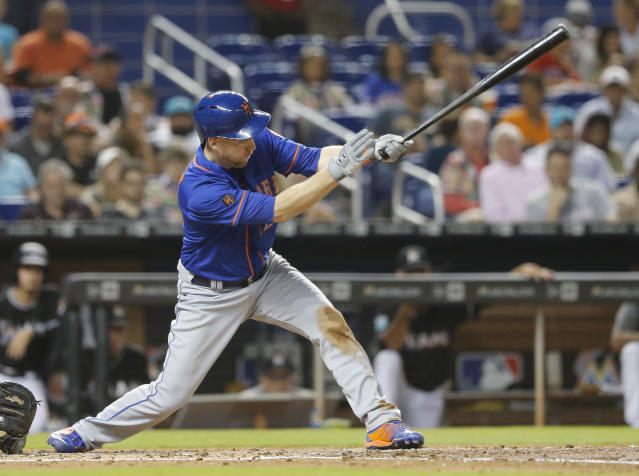 New York Mets hitter Todd Frazier follows through on his three-run double against the Miami Marlins in the fourth inning during their baseball game in Miami, Saturday, Aug. 11, 2018. (AP Photo/Joe Skipper)