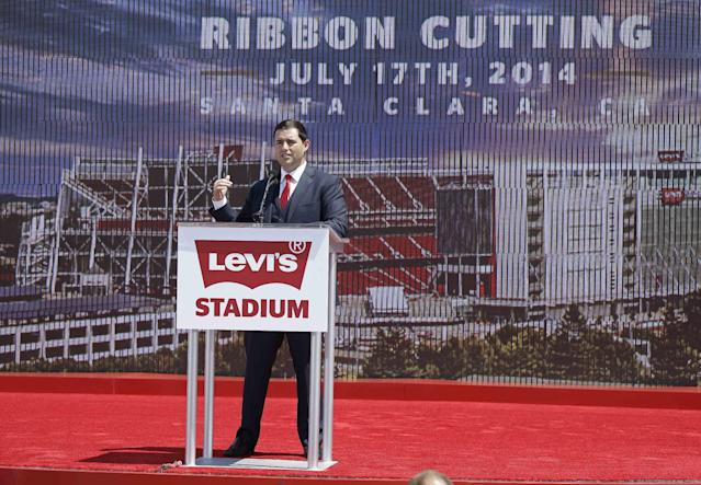 San Francisco 49ers CEO Jed York speaks before the ribbon-cutting and opening of Levi's Stadium Thursday, July 17, 2014, in Santa Clara, Calif. The San Francisco 49ers held a ribbon-cutting ceremony to officially open their new home. The $1.2 billion Levi's Stadium, which took only about 27 months to build, also will host the Super Bowl in 2016 and other major events. (AP Photo/Eric Risberg)